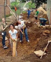 Volunteers helping build and landscape